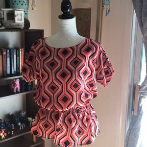 Peach, coral and black geometric Design blouse